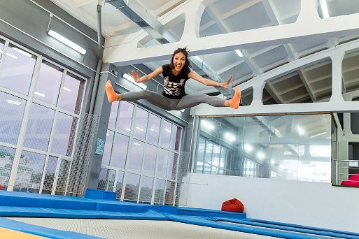 girl jumping in a trampoline